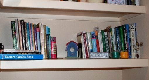 shelf of gardening books