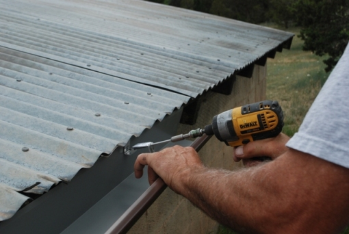 attaching metal gutter to shed