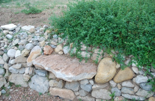 rock bench in wall